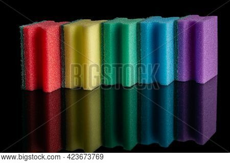 Colorful Sponges For Washing Dishes In The Color Of The Rainbow. On A Black Background With A Reflec