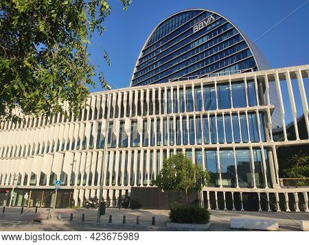 Madrid, Spain - June 14, 2021. Glass Building In The Shape Of A Candle, Being The Headquarters Of Th