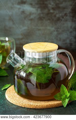 Therapeutic Herbal Tea. Hot Mint Tea On A Dark  Stone Or Concrete Background. Copy Space.
