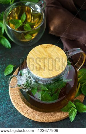 Therapeutic Herbal Tea. Hot Mint Tea On A Dark  Stone Or Concrete Background.