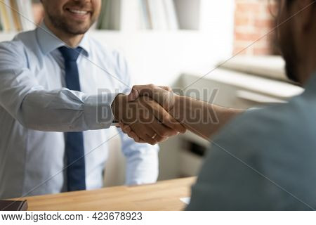 Close Up Happy Two Business Men Shaking Hands, Making Agreement.