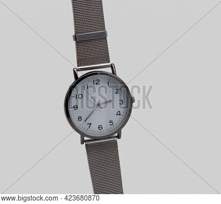 Wristwatch With A Metal Strap. Close-up. Isolated On A Gray Background.