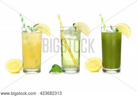 Set Of Summer Iced Green Teas In Glasses With Paper Straws Isolated On A White Background. Iced Gree
