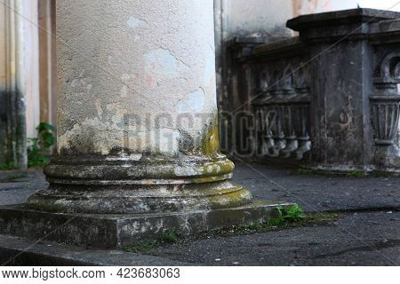 Architectural Columns With Traces Of Destruction And Overgrown With Moss. Mold And Moss On Old, Aban