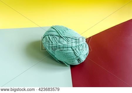 A Skein Of Green Yarn On A Colored Background Close Up Knitting In Self Isolation