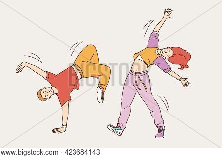 Feeling Positive And Dancing Concept. Young Smiling Cheerful Girl And Boy In Stylish Bright Clothes