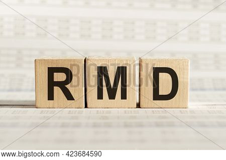 Rmd Abbreviation - Required Minimum Distributions, On Wooden Cubes On A Light Background.
