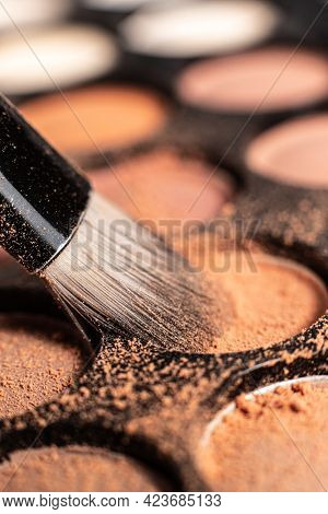 Eye Shadow Is Close. A Makeup Brush With Eye Shadow On It Scatters The Grains. Macro Palettes With S