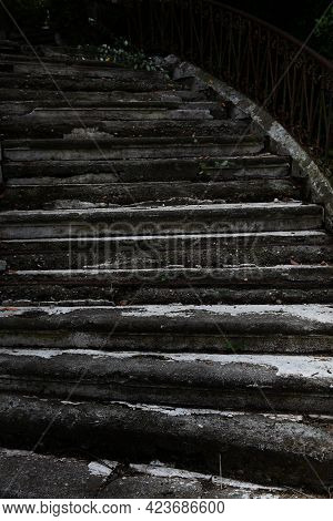 Old Destroyed Concrete Staircase In The Park. Close-up Signs Of Destruction. Vertical Photo With Gru