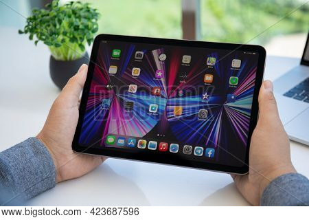Alanya, Turkey - May 11, 2021: Man Hand Holding Ipad Air Ios 14 With Widget On The Home Screen. Ipad