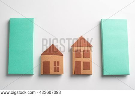 Paper Houses Made By A Kid And Green Rectangles On White Background
