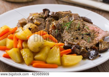 Roast Beef With Potatoes And Carrots. High Quality Photo.