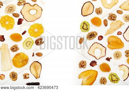 Above View Of Well Laid Out Dried Fruits Apples, Mango, Orange, Dried Apricots, Kiwi, Dried Coconut