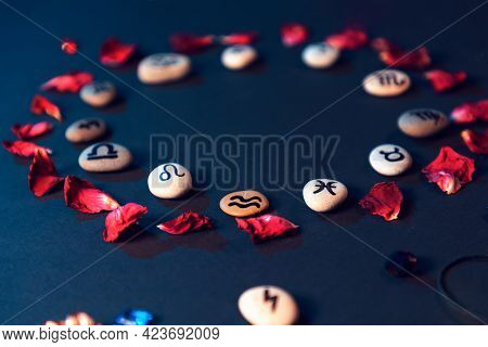Astrology And Horoscope. Stones With The Signs Of The Zodiac, Laid Out In A Circle, Decorated With R
