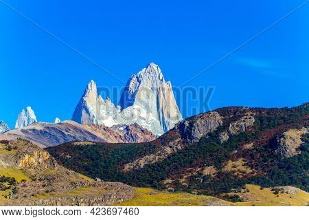 Fitzroi or Chaltel - mountain peak in Patagonia in the border area between Argentina and Chile. The mountain range, illuminated by sunrise. The concept of extreme, active and photo tourism
