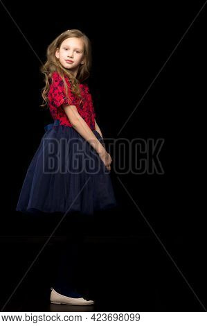 Beautiful Girl In A Red Dress In A Tutu, A Beautiful Girl In Fashionable Clothes Posing In The Studi