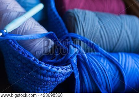 Skeins Of Knitted Yarn. Grey, Burgundy, Blue Threads In Unfinished Knitted With Hook Bag. Handmade A