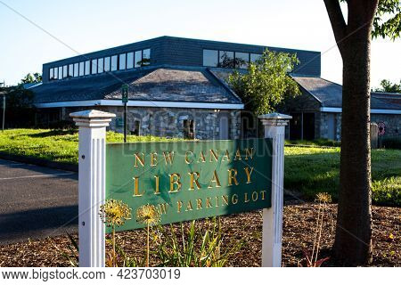 NEW CANAAN, CT, USA- JUNE 13, 2021: New Canaan library building with sign