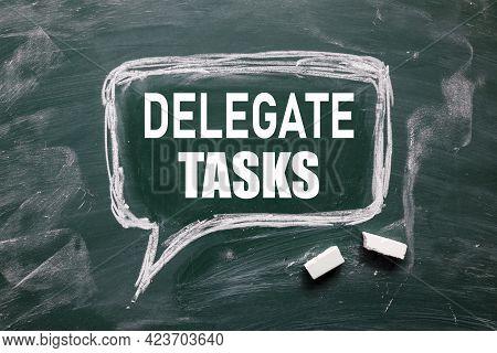 Delegate Tasks. Chalk Board Text. White Font