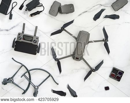 Set Of Folding Drone Or Quadcopter With Many Accessories, Top View Or Flat Lay. Kit Of Folding Drone