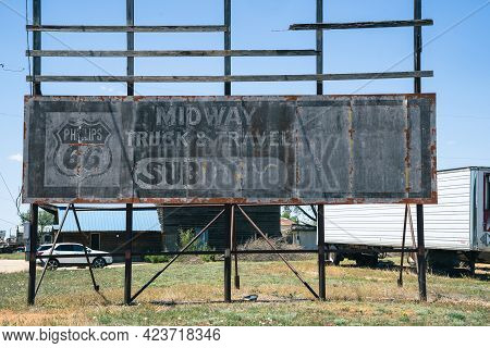 Shamrock, Texas - May 6, 2021: Old Faded Billboard Sign Advertising A Phillips 66 Gas Station And Su