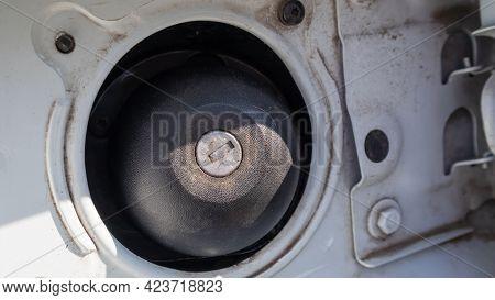 Fuel Cap Of A White Sports Car. Close The Gas Tank Cap. The Fuel Tank Is Open. The Fuel Filler Door