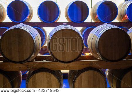 Champagne Brut Sparkling Wine Production In Oak Wooden Barrels In Underground Cellar, Reims, Champag