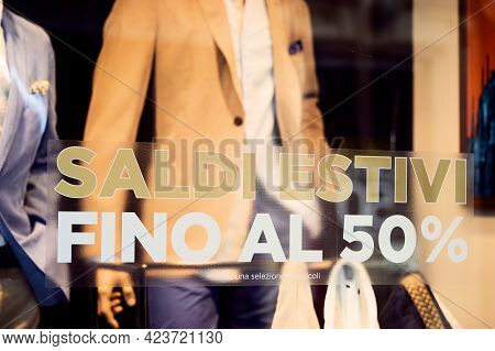 Sale 50 Off Sticker On Glass Window Display With Mannequin In Italian Fashion Store. Discount Sign S