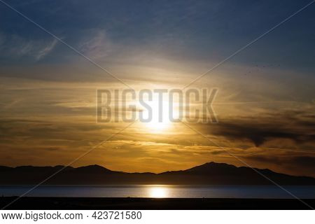 Panoramic View Onto Golden Sunset Above Waters Of Van Lake. Silhouettes Of Mountains Are On Backgrou