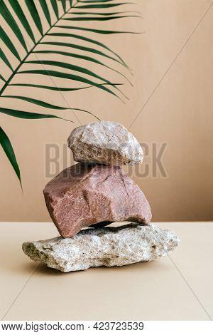 Empty Podium Stones Tower On Kraft Brown Paper Background. Stones Pedestal Display On Beige Backgrou