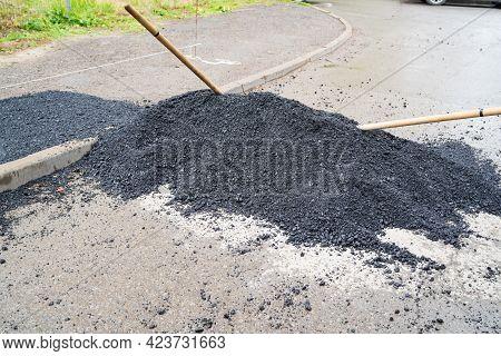 Heap Asphalt On Road. Violations Of Roadworks Rules