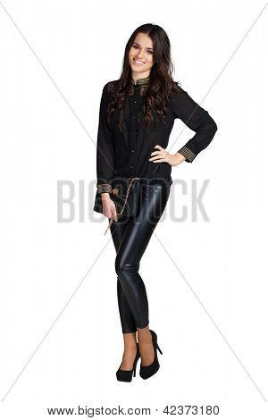 Mujer de glamour elegante con leggins y blusa azul