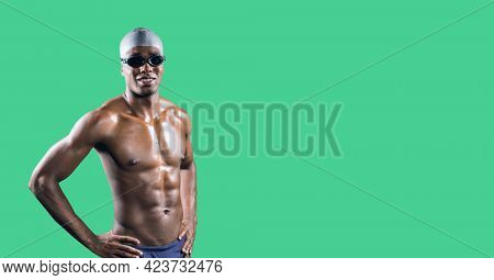 Composition of smiling male swimmer with copy space isolated on green background. sports and competition concept digitally generated image.