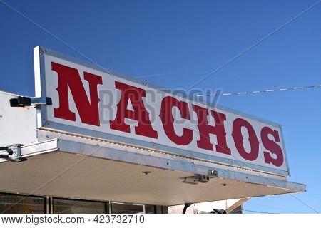 Food Vendor At County Fair Nachos Sign