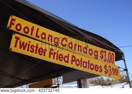 Food Vendor At County Fair Corndogs And Fried Potatoes