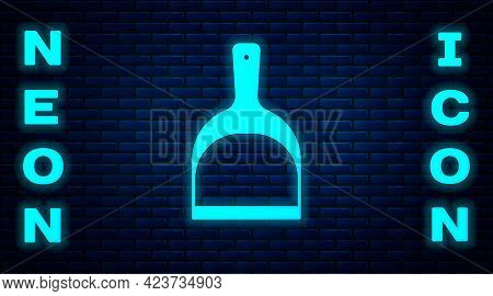 Glowing Neon Dustpan Icon Isolated On Brick Wall Background. Cleaning Scoop Services. Vector