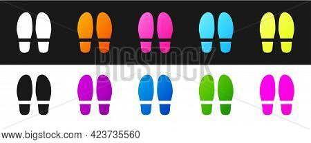 Set Footsteps Icon Isolated On Black And White Background. Detective Is Investigating. To Follow In