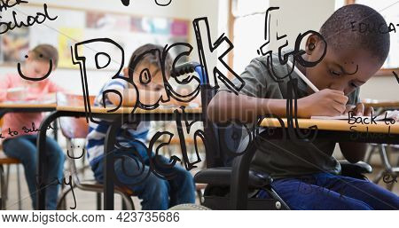 Composition of back to school text in black over schoolchildren working at desks in classroom. school, education and study concept digitally generated image.