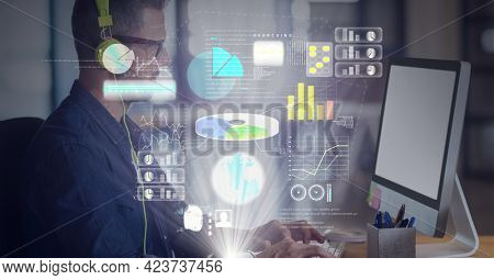Data processing over world map against caucasian man wearing headphones using computer. global business and technology concept