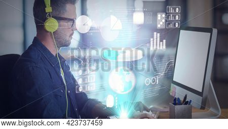 Digital interface with data processing against caucasian man wearing headphones using computer. global business and technology concept