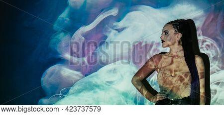 Feminine Beauty. Blossom Energy. Miracle Nature. Conceptual Art. Confident Woman Bright Makeup Posin