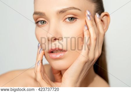 Skin Care. Facial Treatment. Freshness Wellness. Confident Woman With Nude Makeup Touching Radiant C