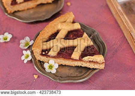 Slice Of Pie Called 'linzer Torte', A Traditional Austrian Shortcake Pastry Topped With Fruit Preser