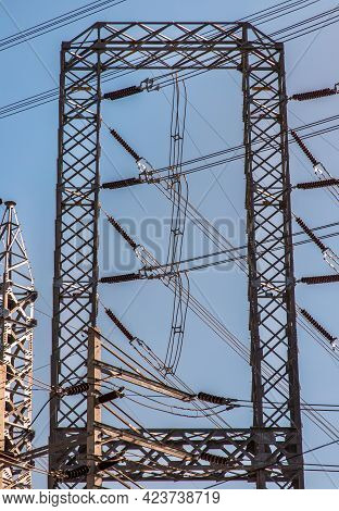 Electrical Poles Of High Voltage With Electric Pole Power Lines And Wires With Blue Sky. High Voltag