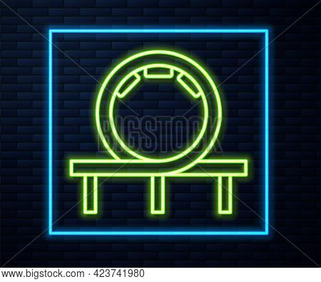 Glowing Neon Line Roller Coaster Icon Isolated On Brick Wall Background. Amusement Park. Childrens E
