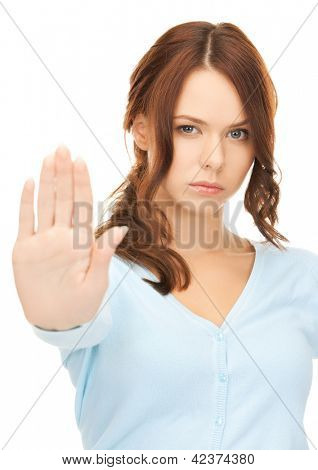 bright picture of young woman making stop gesture.. poster