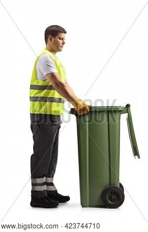 Full length profile shot of a waste collector with a green dustbin isolated on white background