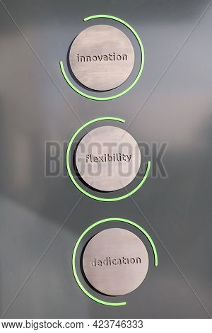 engraving a cnc machine on a piece of metal. Engraving dedication, flexibility and inovation text