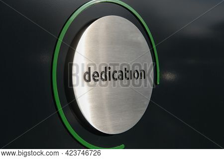 engraving a cnc machine on a piece of metal. Engraving dedication text