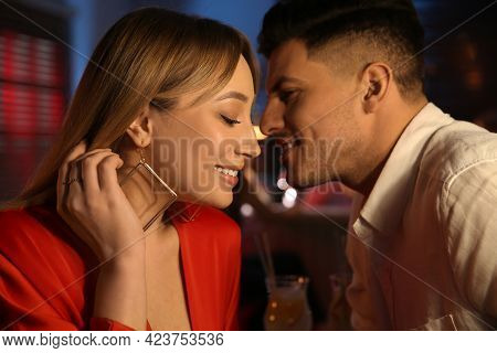 Man And Woman Flirting With Each Other In Bar
